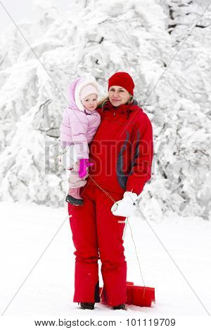 mother and her little daughter with bob in snow