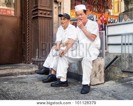 NEW YORK,USA- AUGUST 19,2015 : Senior chinese immigrants at Chinatown in Manhattan