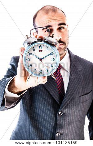 Businessman Holding Alarm Clock