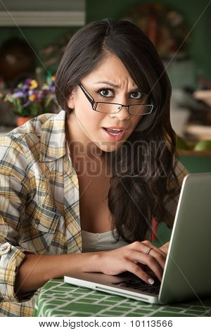 Shocked Beautiful Latina Woman With Computer