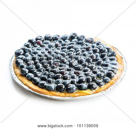 Tart with blueberries on a white background