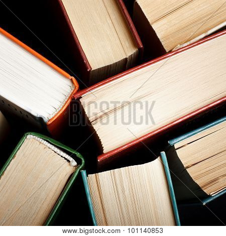 Old and used hardback books or text books seen from above. Books and reading are essential for self