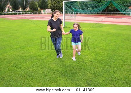 Girls Have Fun On The Stadium