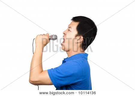 man with a microphone singing
