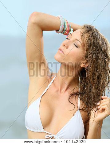 Woman in bikini with wet hair, fashion beauty