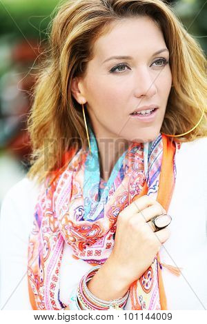 Portrait of beautiful smiling woman with colourful scarf