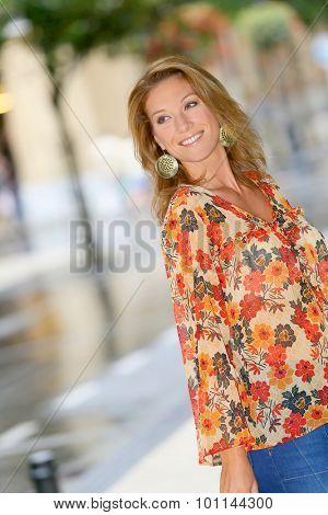 Trendy girl doing shopping in city street