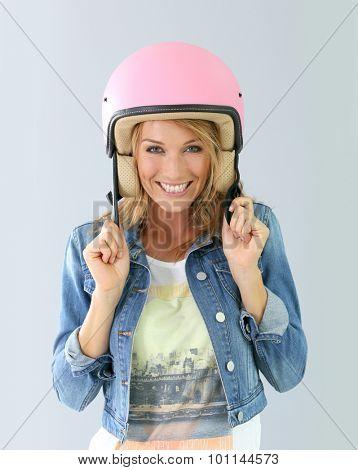 Cheerful girl wearing security helmet, isolated
