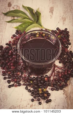 Vintage Photo, Bunch Of Fresh Elderberry With Juice On Old Wooden Background, Healthy Nutrition