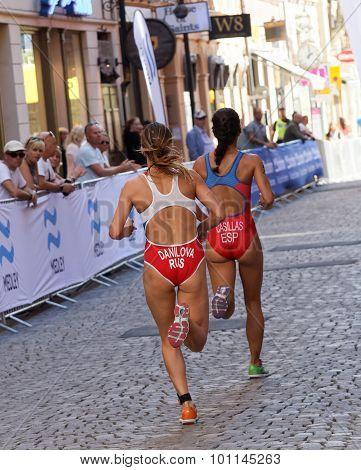 Rear View Of Triathlete Miriam Casillas Garcia Running, Followed By Elena Danilova
