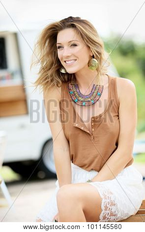 Trendy model girl sitting on outdoor chair