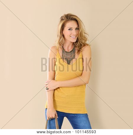 Beautiful blond chic woman with purse, isolated