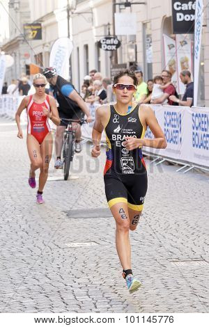 Triathlete Anja Knapp Running, Followed By Gaia Peron