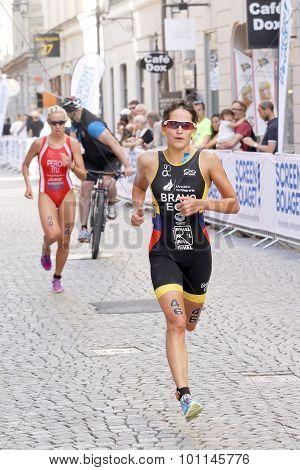 Triathlete Anja Knapp Running, Followed By Gaia Peron