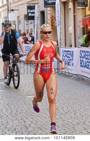 Triathlete Gaia Peron Running, Followed By Cyclist