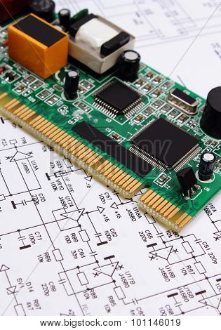 Printed Circuit Board Lying On Diagram Of Electronics, Technology