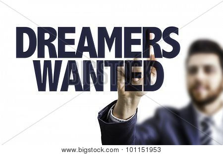 Business man pointing the text: Dreamers Wanted