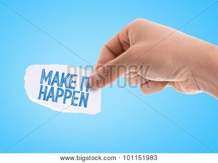 Piece of paper with the word Make It Happen with blue background