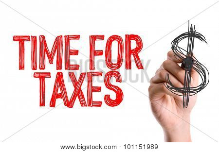 Hand with marker writing the word Time for Taxes