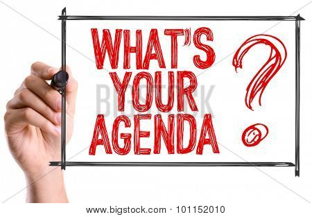 Hand with marker writing the word Whats Your Agenda?