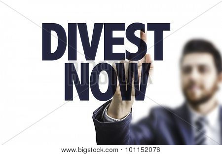Business man pointing the text: Divest Now