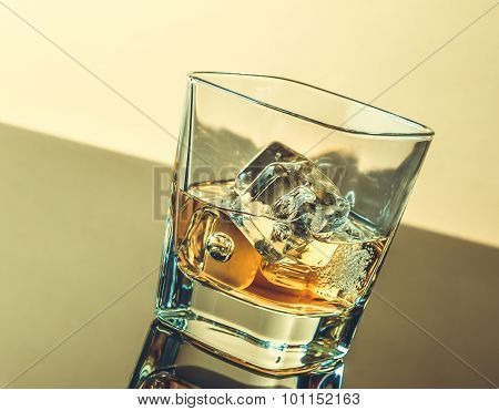 Glass Of Whiskey On Table With Reflection, Warm Atmosphere