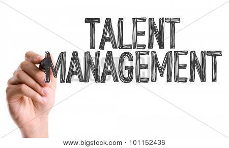 Hand with marker writing the word Talent Management