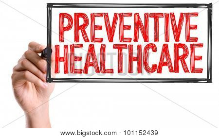 Hand with marker writing the word Preventive Healthcare
