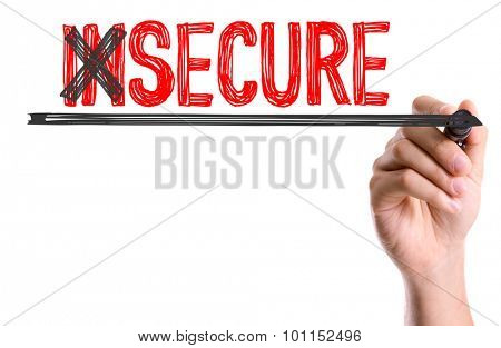 Hand with marker writing the word Insecure/Secure