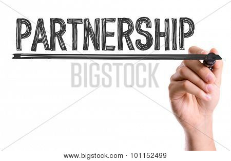Hand with marker writing the word Partnership