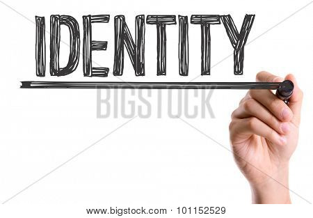Hand with marker writing the word Identity