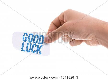 Piece of paper with the word Good Luck isolated on white background