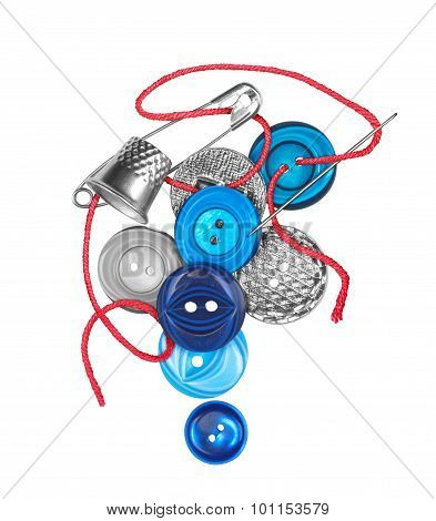 Red Thread With Needle Sews The Blue Button Isolated On White Background