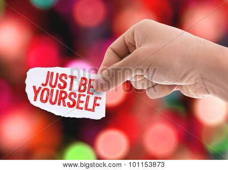 Piece of paper with the word Just be Yourself with bokeh background