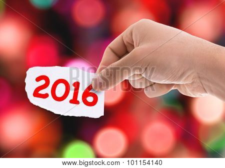 Piece of paper with the word 2016 with bokeh background
