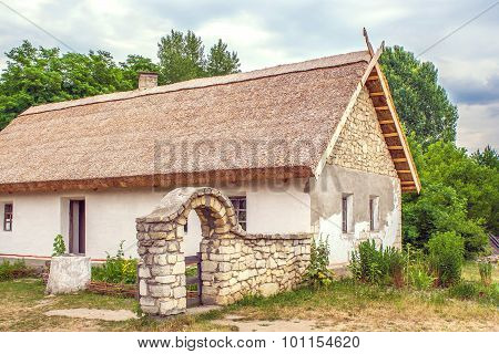 Ukrainian Stone House Under A Thatched Roofs