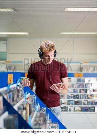 Guy Listening Music In Cd Store