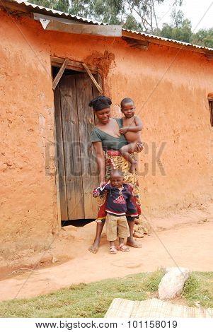 An Unidentified African Woman With Her Children On The Doorstep 40