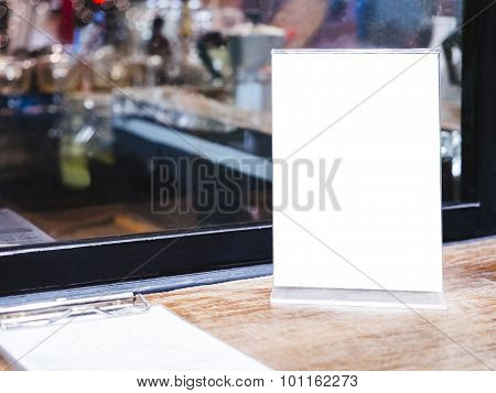 Mock Up Menu Frame On Table with Bar Restaurant Cafe