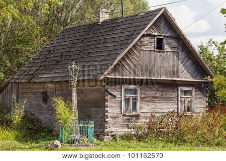 Old House And Cross In Front Of Building In Aleksicze Poland