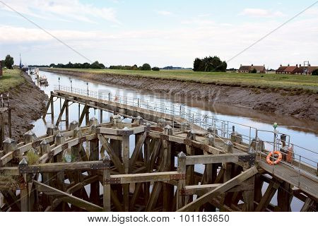 Approach On River Nene At Low Tide To Crosskeys Bridge At Sutton Bridge, Lincolnshire. Intricate Woo
