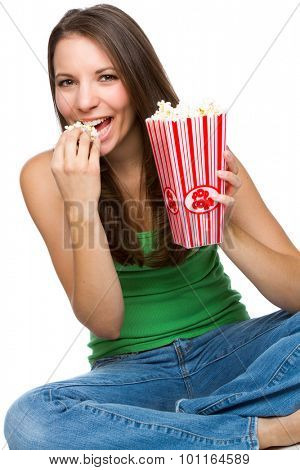 Beautiful young woman eating popcorn