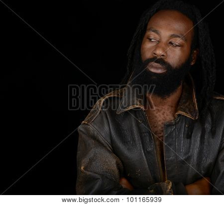 Attractive Afro man in leather