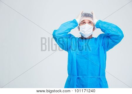 Portrait of anxiety surgeon standing isolated on a white background