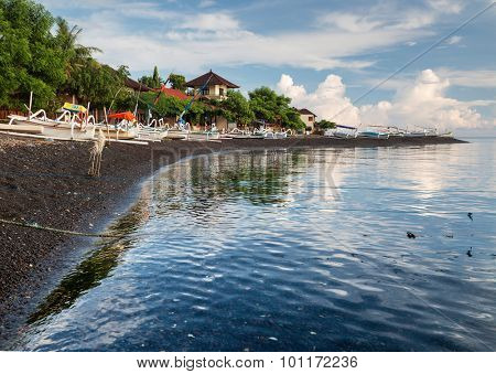 Calm sunrise in the bay with wooden boats, Indonesia