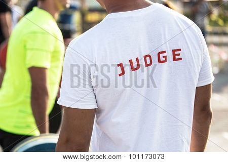 Back view portrait of a sports judge outdoors