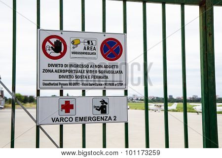 Sign Forbidding Gate Mounted On Civilian Airport