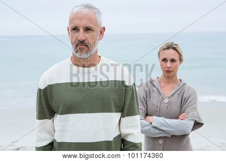 Woman angry at her partner at the beach