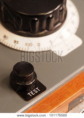 Test button on an old test apparatus
