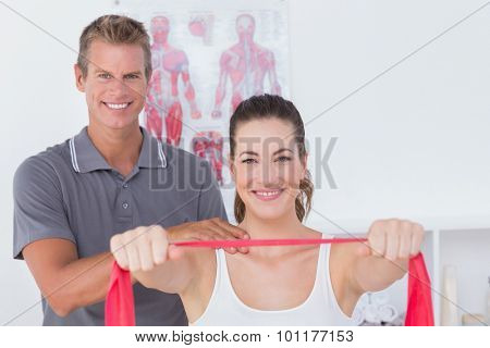 Happy doctor examining his patient back in medical office